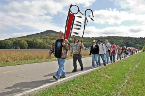 The Walkers were led by a Native American carrying a sacred staff.