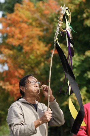 Native American spiritual leader Gilly Running blows his sacred whistle at a ceremony along the route.